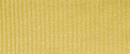 Yellow wool fabric as background.
