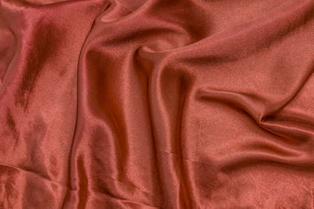 Red shiny fabric as a background. 写真素材