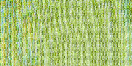Green wool fabric as background.