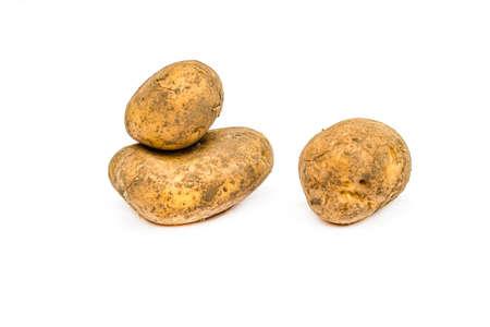 Potato tubers close-up on a white background. Standard-Bild