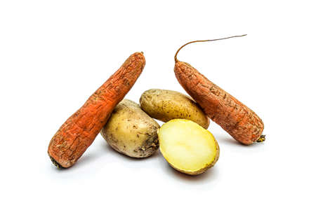 Boiled vegetables in a peel carrots and potatoes on a white background