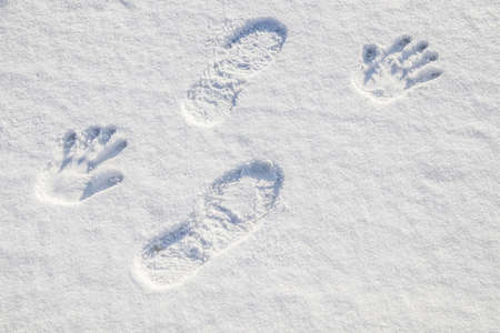 Footprints in white fresh snow.