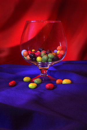 glass vase: Glass vase with nuts in colored glaze Stock Photo