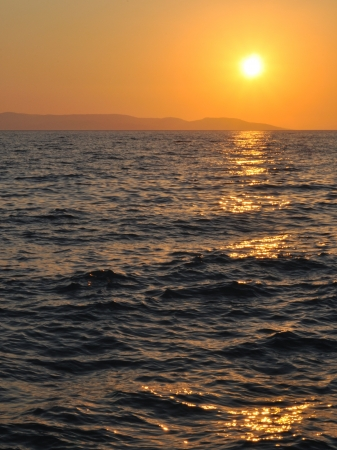 Sunset at sea with ripples