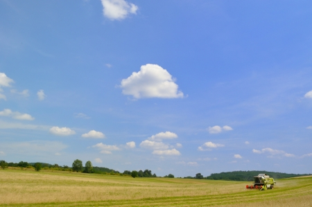 Combine harvester at work on field Agriculture and Farming Collection  photo