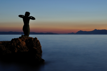 Statue of the mermaid in Podgora in evening Stock Photo