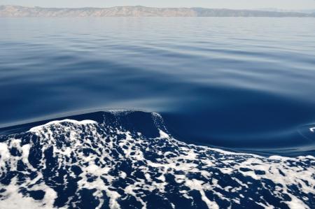 brac: Waves on adriatic sea  Island Brac in background Stock Photo