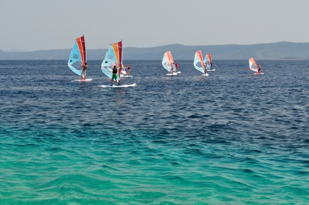 wind surfing: Windsurfing on amazing beach Zlatni rat  Golden Cape  in Bol on island Brač in the Split-Dalmatia County of Croatia