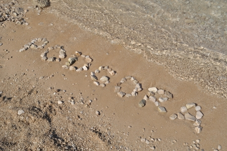 The Podgora word spelled out with pebbles on beach of Podgora  Stock Photo