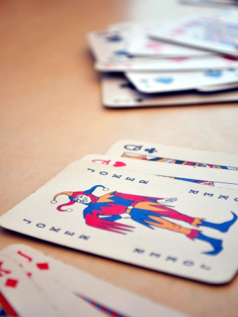 Detail view of poker cards, focused on Joker Editorial