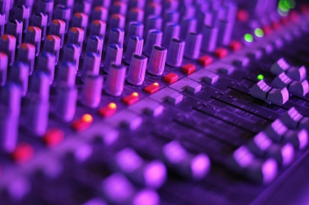 View of music mixer in concert, filled with lights Stock Photo