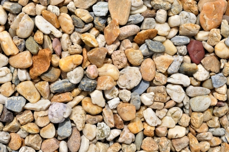 Background of colorful beach pebbles of different shape and size