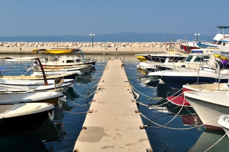 Yachts and boats in port of Podgora, Croatia photo