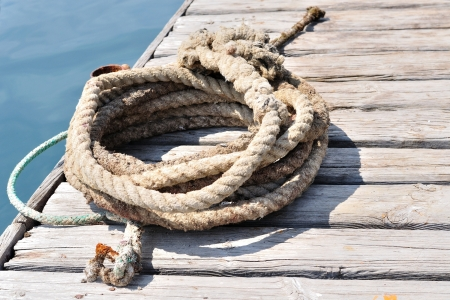 Coiled marine rope on wooden pier  Podgora, Croatia