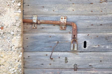 Old, abandoned, gray, wooden door with padlock, Croatia Stock Photo - 21213928