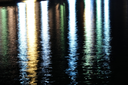 Colorful lights reflecting on sea surface, Podgora, Croatia  Abstract view Stock Photo - 21213952