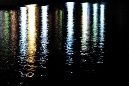 Colorful lights reflecting on sea surface, Podgora, Croatia  Abstract view