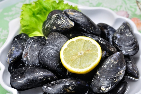 Decorative plate of delicious mussels with lemon