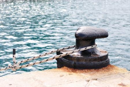 Marine rope on mooring bollard in port of Podgora, Croatia photo