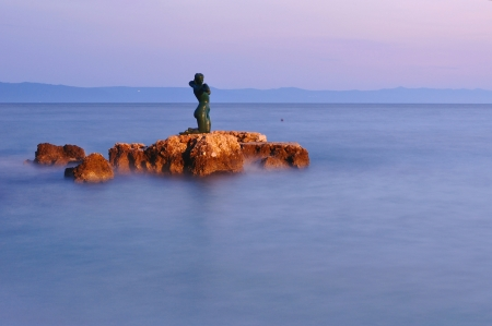 Statue of the mermaid in Podgora in evening, Croatia Stock Photo