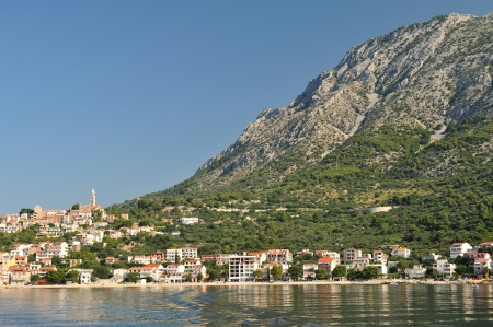 Village of Igrane with tower, adriatic sea and high mountain Biokovo in background  Makarska Riviera, Croatia