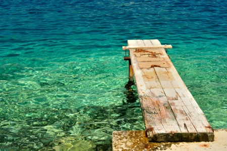 View of a wooden pier over beautiful adriatic sea  Korcula, Croatia