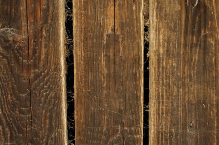 Old brown wooden planks with spider web for background photo