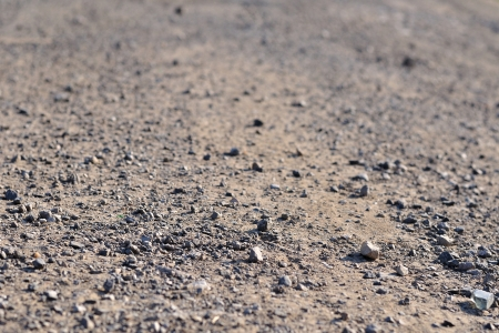 Terrain road with small rocks on the ground viewed from near the ground Stock Photo
