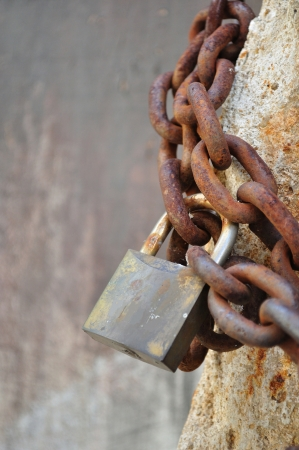 Detail of old, rusty padlock and metal chain  Vertical photo Stock Photo - 25145716