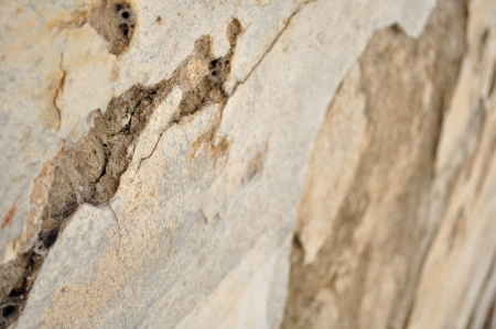 Detail of weathered, old wall in perspective as background  Shallow DOF