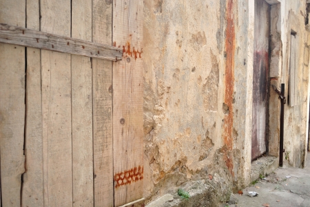 lock block: Old abandoned house with wooden doors Stock Photo