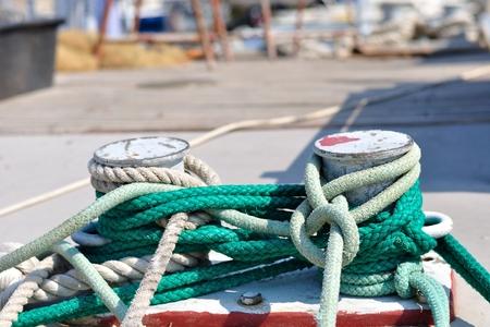 Marine rope on mooring bollard in port of Podgora, Croatia  Horizontal photo photo