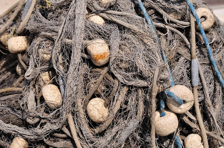 Texture of pile of fishing nets with floats  Podgora, Croatia