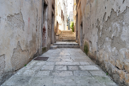 Narrow street in old medieval town Korcula by sunny day   Dalmatia, Croatia, Europe