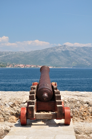 Old cannon at old fortress in medieval town Korcula in Croatia  Vertical image