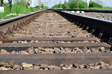 Detail of railway tracks with girder and gravel photo