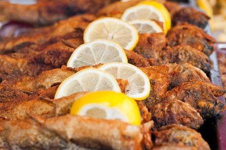 Fresh fried fish with lemon slice photo