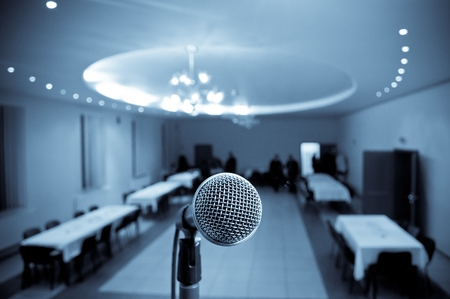 Microphone in concert hall or conference room with blue tone Stock Photo