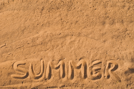 The word summer carved in the sand of a beach.  Vacation concept background Stock Photo