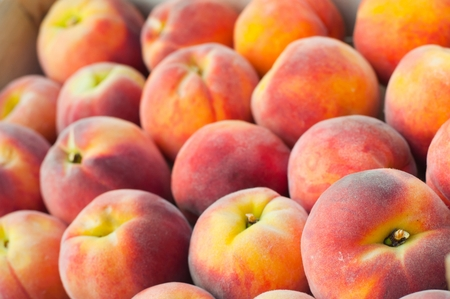 Fresh peach heap. Fruit background. Shallow DOF