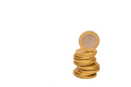 1 euro: Stack of Euro coins with 1 Euro coin on the top isolated on white background - euro money, savings