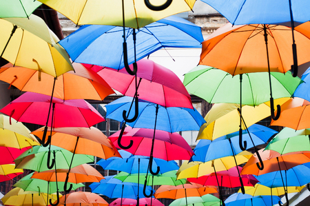Street decoration with colorful open umbrellas hanging over the alley. Kosice, Slovakia. Color background Stock Photo