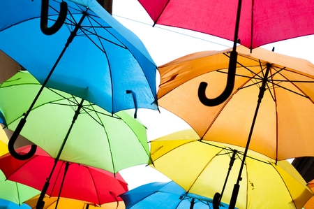 rainbow umbrella: Many colorful umbrellas against the sky in city settings. Kosice, Slovakia. Color background Stock Photo