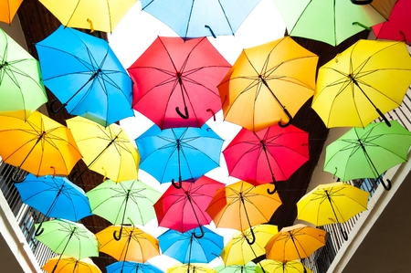 Street decoration with colorful open umbrellas hanging over the alley. Kosice, Slovakia Stock Photo