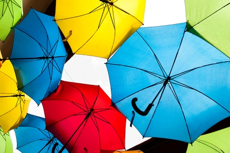 Many colorful umbrellas against the sky in city settings. Kosice, Slovakia. Color background Stock Photo