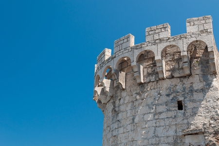 One of the towers in the ancient town wall of Korcula in Croatia. Blue sky in background