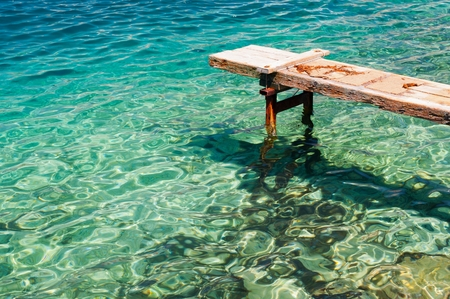 View of a wooden pier over beautiful adriatic sea. Korcula, Croatia. Space in left side