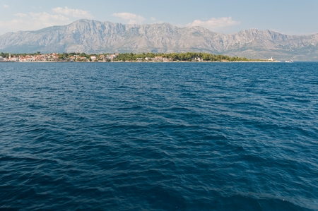 Town Sucuraj on south end of island Hvar in the Adriatic sea with mountain Biokovo in background. Croatia
