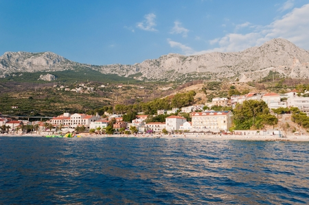 Village Podgora with hotels and Biokovo mountain in background. Podgora is a popular holiday resort in Croatia