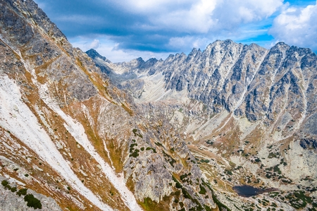 View of mountains from Solisko in High Tatras in Slovakia with cloudy blue sky